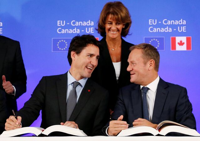 Canada's Prime Minister JustinTrudeau and European Council President Donald Tusk attend the signing ceremony of the Comprehensive Economic and Trade Agreement (CETA), at the European Council in Brussels, Belgium, October 30, 2016