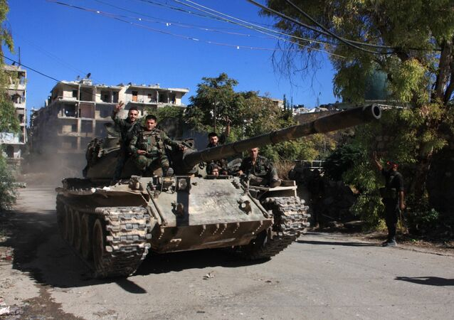 Syrian pro-government forces take part in an operation to take control of Aleppo's Suleiman al-Halabi neighbourhood, which is divided by the frontline that separates the rebel-held east and regime-held west of the northern city, on September 30, 2016