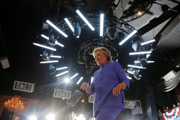 U.S. Democratic presidential nominee Hillary Clinton walks off the stage at a campaign rally at the Manor Complex in Wilton Manors, Florida, U.S. October 30, 2016 - Sputnik International