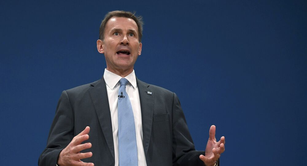 Britain's Health Secretary Jeremy Hunt delivers his keynote address at the annual Conservative Party Conference in Birmingham, Britain, October 4, 2016.