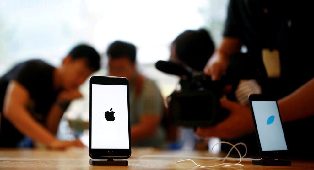 Members of the media film the new iPhone 7 at an Apple store in Beijing, China, September 16, 2016