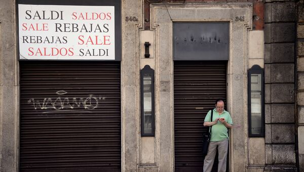 A man stands outside a closed shop indicating sales, in the shopping street of Via del Corso, in central Rome on July 3, 2016 - Sputnik International