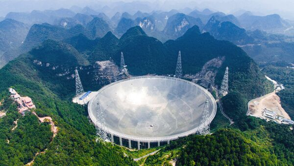 In this Saturday, Sept. 24, 2016 photo released by Xinhua News Agency, an aerial view shows the Five-hundred-meter Aperture Spherical Telescope (FAST) in the remote Pingtang county in southwest China's Guizhou province - Sputnik International
