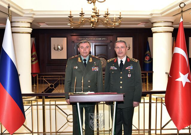 Turkey's Chief of Staff Gen. Hulusi Akar, right, and his Russian counterpart Gen. Valery Gerasimov pose for a photograph before their talks in Ankara, Turkey, Thursday, Sept. 15, 2016