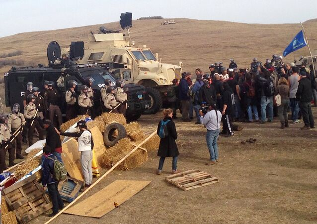 A line of police move towards a roadblock and encampment of Native American and environmental protesters near an oil pipeline construction site, near the town of Cannon Ball, North Dakota, U.S. October 27, 2016