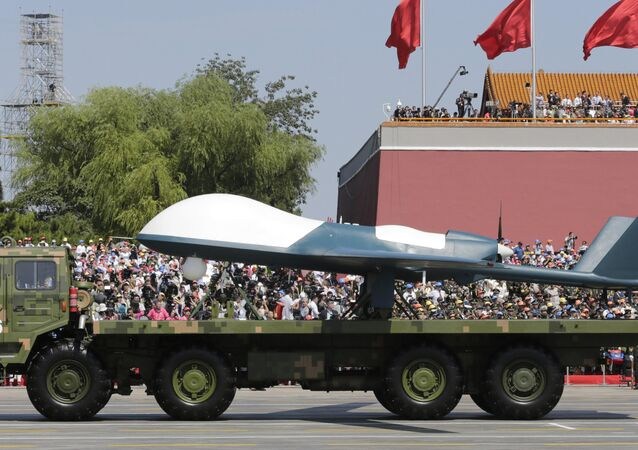 A military vehicle carries a Pterodactyl I unmanned aerial vehicle past the Tiananmen Gate during a military parade to commemorate the 70th anniversary of the end of World War II in Beijing Thursday, Sept. 3, 2015