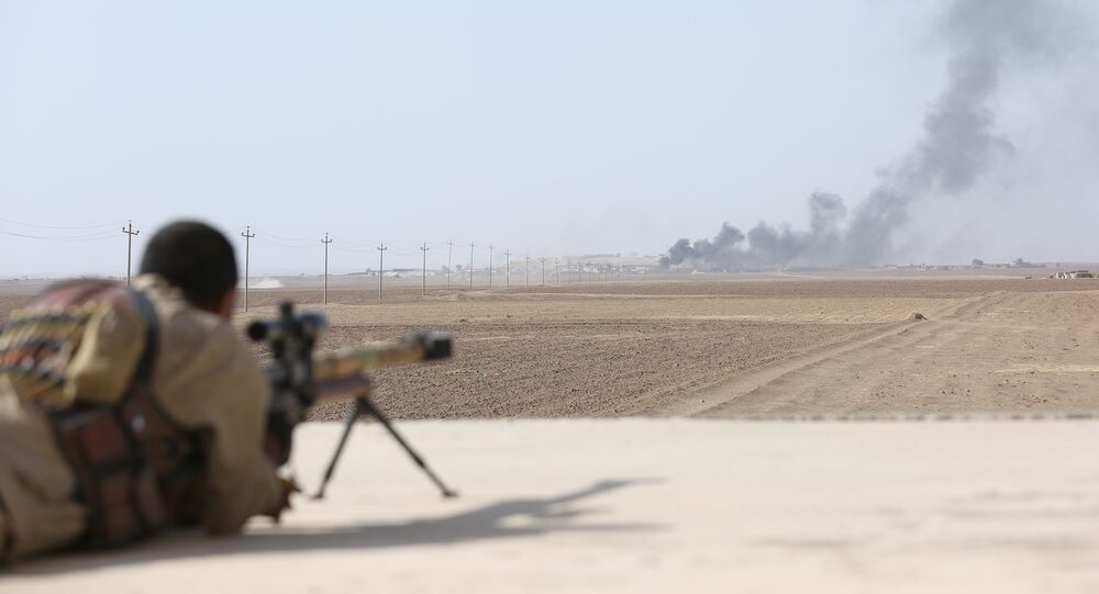 Smoke rises at Islamic State militants' positions southwest of Mosul, Iraq October 31, 2016