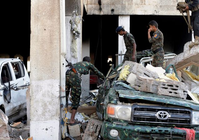 Men inspect the site of an airstrike which witnesses said was by Saudi-led coalition aircraft on mourners at a hall where a wake for the father of Jalal al-Roweishan, the interior minister in the Houthi-dominated Yemeni government, was being held, in Sanaa, Yemen October 8, 2016.