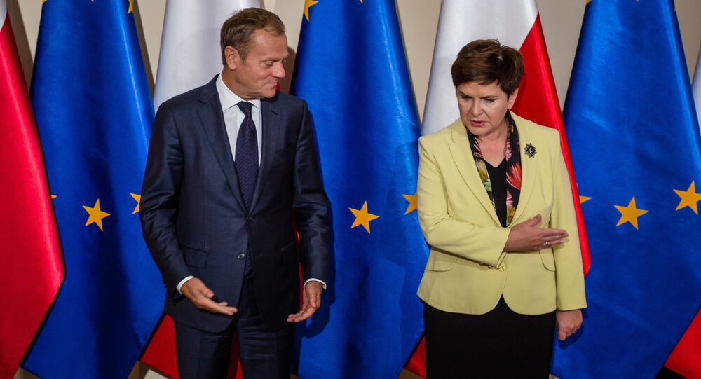 The President of the European Council and former Polish Prime Minister Donald Tusk (L) is welcomed by Polish Prime Minister Beata Szydlo (R) during an official reception in Warsaw on September 13, 2016.