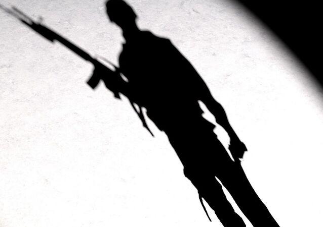A silhouette of a man with a gun