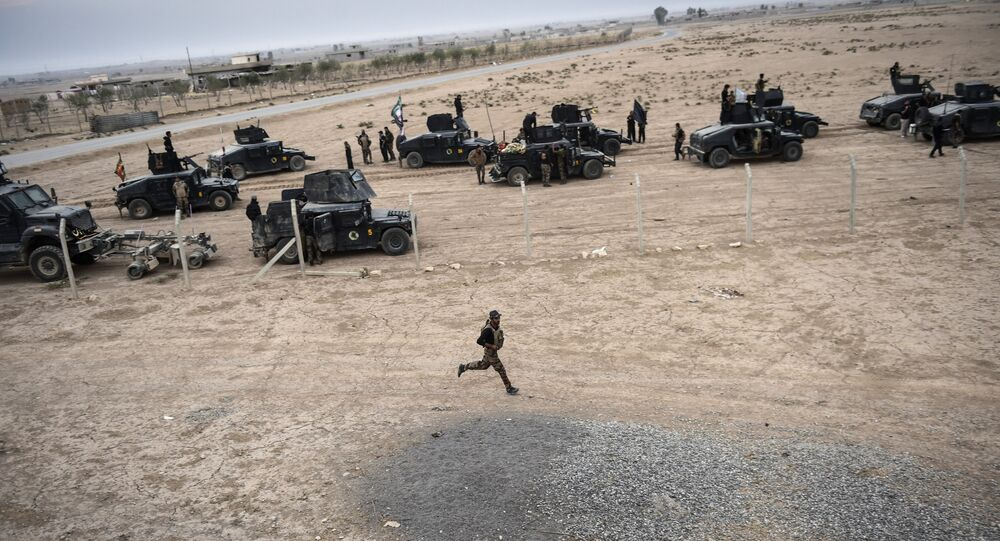 Members of the Iraqi Counter Terrorism Service (CTS) drive near the village of Bazwaya, on the eastern edges of Mosul, tightening the noose on Mosul as the offensive to retake the Islamic State group stronghold entered its third week on October 31, 2016