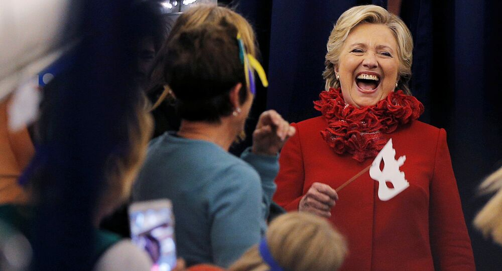 US Democratic presidential nominee Hillary Clinton holds a Halloween mask (File)
