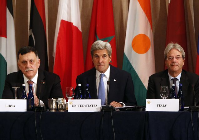 Libya's Prime Minister Fayez al-Sarraj, U.S. Secretary of State John Kerry and Italy's Foreign Minister Paolo Gentiloni participate in a ministerial meeting on Libya 2016
