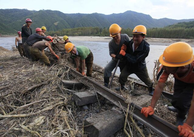 In this Friday, Sept, 16, 2016, file photo, workers repair the flood-damaged train track between Sinjon and Kanphyong train stations in North Hamgyong Province, North Korea