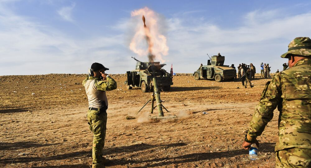 Iraqi forces fire mortar shells towards Daesh positions on October 21, 2016, on the frontline on the outskirts of Qayyarah, about 30 kilometres south of Mosul, during an operation to retake the main hub city from Daesh