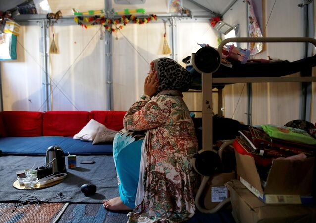 Syrian refugee Walaa, 26, sits inside her family's tent at the Souda municipality-run camp on the island of Chios, Greece, September 7, 2016.