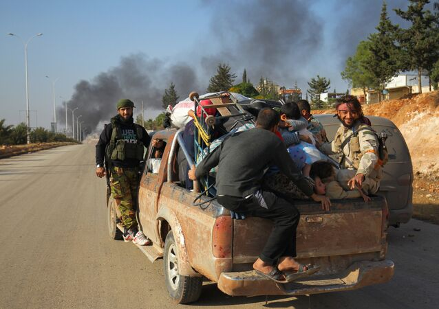 Rebel fighters ride a pick-up truck with civilians who fled areas of conflict in Dahiyet al-Assad, west Aleppo city, Syria October 30, 2016
