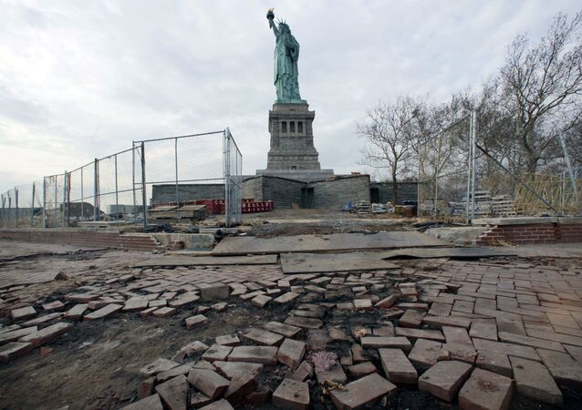 The Statue of Liberty stands beyond parts of a brick walkway damaged in Superstorm Sandy on Liberty Island in New York (File)