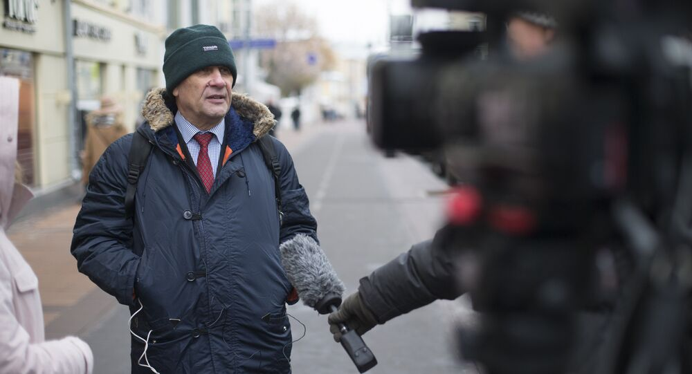 Sergei Nikitin, the head of Amnesty International in Russia speaks to the media in Moscow, Russia, Wednesday, Nov. 2, 2016