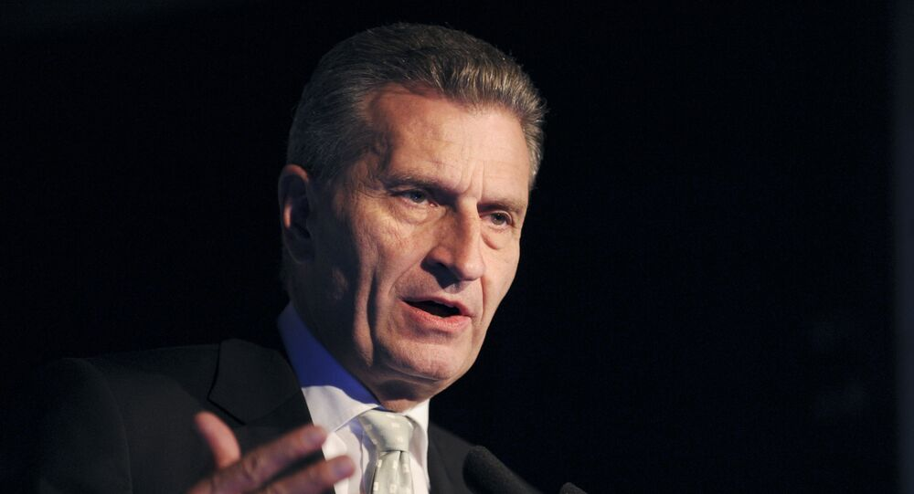 European Commissioner Gunther Oettinger addresses the opening of French employers' association Medef's Universite du Numerique at the Medef headquarters in Paris on June 10, 2015