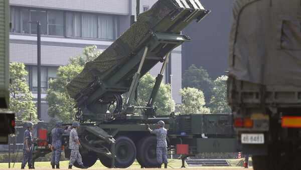 Japan Self-Defense Force members set up a PAC-3 Patriot missile unit deployed ahead of North Korea's planned rocket launch at the Defense Ministry in Tokyo, Tuesday, June 21, 2016 - Sputnik International