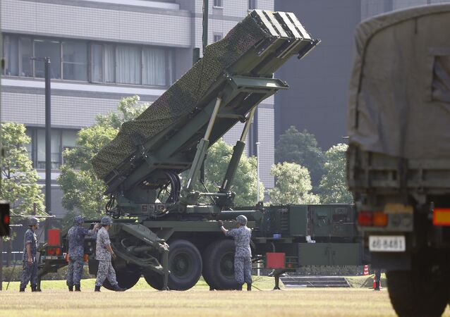 Japan Self-Defense Force members set up a PAC-3 Patriot missile unit deployed ahead of North Korea's planned rocket launch at the Defense Ministry in Tokyo, Tuesday, June 21, 2016