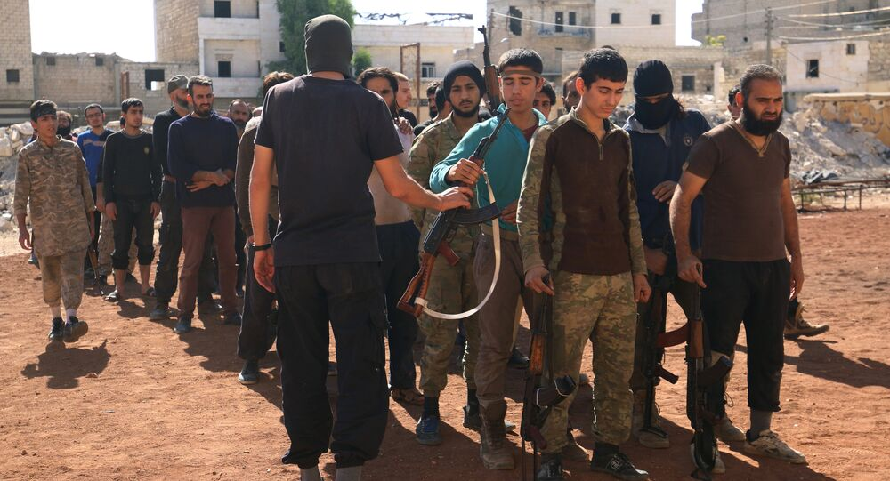 Rebel fighters part of the Jabhat Fatah al Sham, attend military training in the besieged rebel held Aleppo, Syria October 26, 2016