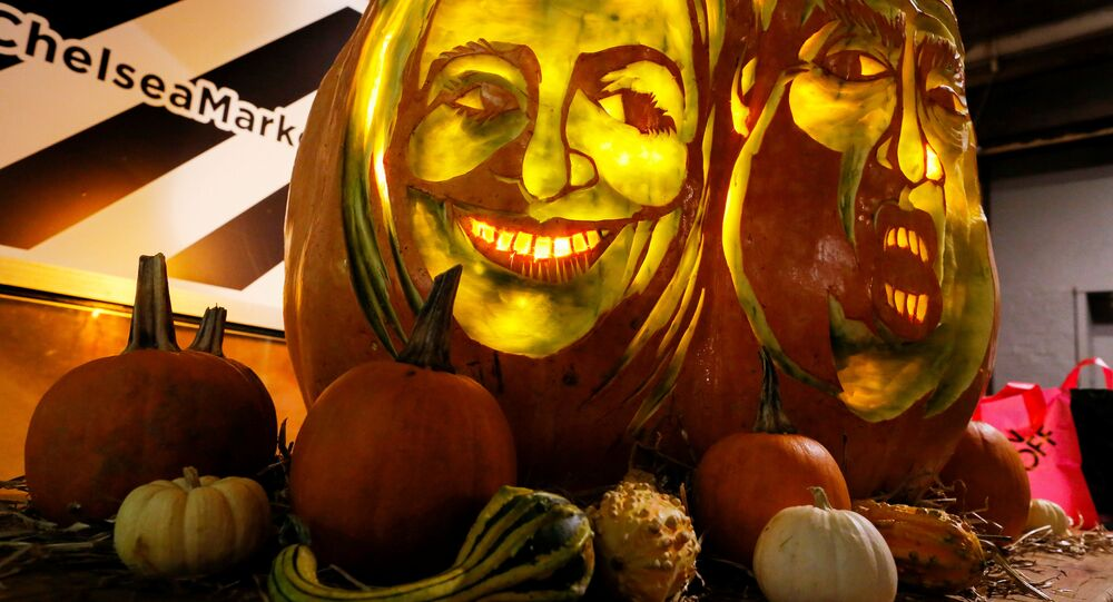 A giant pumpkin created by Master Carver Hugh McMahon with the faces of 2016 Democratic nominee Hillary Clinton and Republican presidential nominee Donald Trump is displayed at Chelsea Market in New York, U.S., October 28, 2016