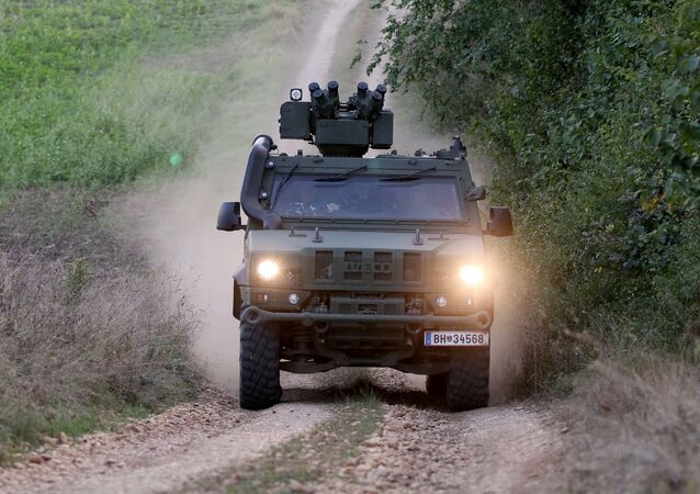 A vehicle of the Austrian army drives to patrol on the border for illegally entering migrants between Hungary and Austria in Nickelsdorf, Austria, Tuesday, Sept. 20, 2016