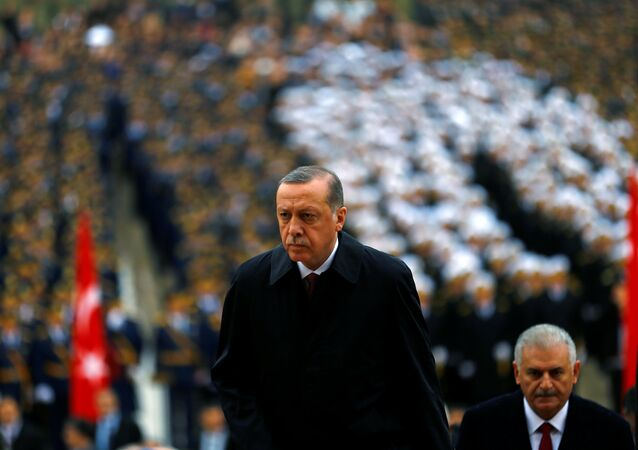 Turkey's President Tayyip Erdogan attends a Republic Day ceremony at Anitkabir, the mausoleum of modern Turkey's founder Ataturk, to mark the republic's anniversary as he is flanked by Prime Minister Binali Yildirim (R) in Ankara, Turkey, October 29, 2016.