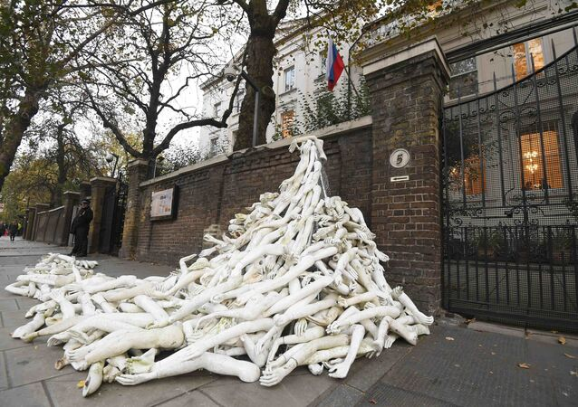 Piles on mannequin limbs are seen outside the Russia's embassy in London as part of a protest against military action in Syria