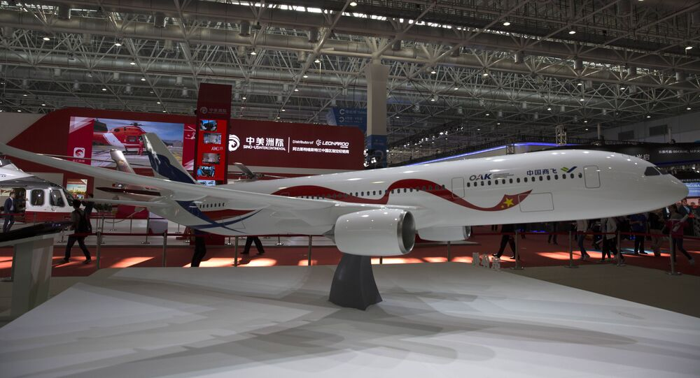 A mock-up scale model of the proposed COMAC C929, a wide-bodied commercial jet to be made by Commercial Aircraft Corporation of China (COMAC) and Russia's United Aircraft Corporation (UAC), is seen on display during the Zhuhai Air Show in Zhuhai, southern China's Guangdong province, on November 3, 2016.
