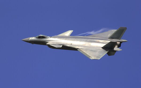 In this photo provided by China's Xinhua News Agency, the J-20 stealth fighter jet flies at the China's International Aviation and Aerospace Exhibition in Zhuhai on Tuesday, Nov. 1, 2016 - Sputnik International