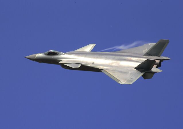 In this photo provided by China's Xinhua News Agency, the J-20 stealth fighter jet flies at the China's International Aviation and Aerospace Exhibition in Zhuhai on Tuesday, Nov. 1, 2016