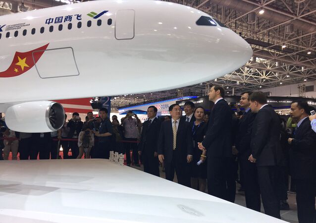 Minister of Trade and Industry of the Russian Federation Denis Manturov talks with Jin Zhuanglong, chairman of Commercial Aircraft Corporation of China (COMAC), during an unveil ceremony at an air show, the China International Aviation and Aerospace Exhibition, in Zhuhai, Guangdong Province, China, November 2, 2016.