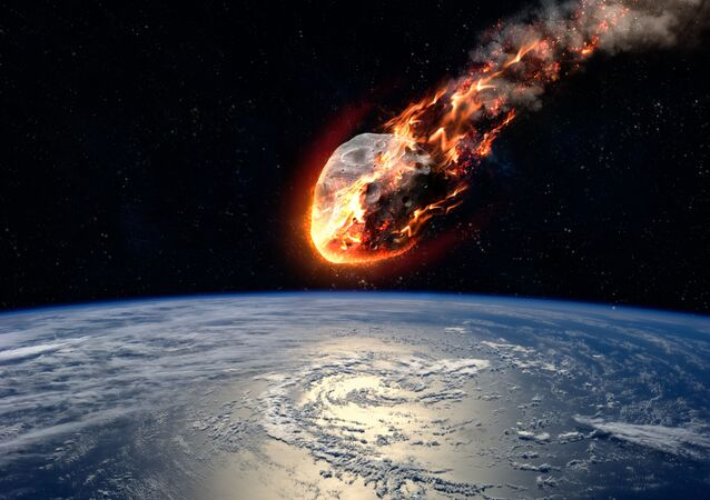 Meteor glowing as it enters the Earth's atmosphere. Elements of this image furnished by NASA.