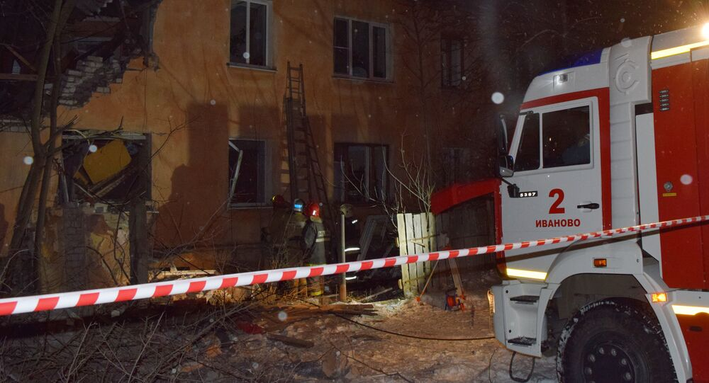 Emergency Ministry's employees work at an explosion site in a residential house in Ivanovo.
