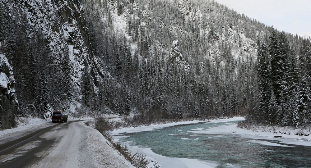 A truck drives along the M54 federal highway on the bank of the Us river in the Western Sayan mountains in Krasnoyarsk region, Russia, November 4, 2016.