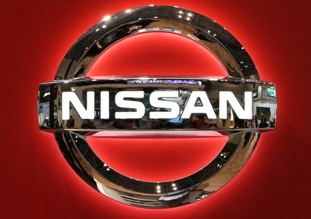 The logo of Japanese auto giant Nissan Motor is seen at the Tokyo Motor Show on November 2, 2015.