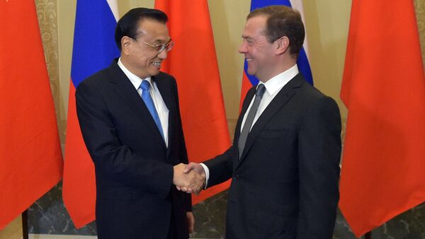 Russian Prime Minister Dmitry Medvedev and Chinese State Council Premier Li Keqiang during the 21st regular meeting between Russian and Chinese government heads in St. Petersburg - Sputnik International