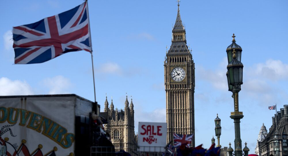 A Union flag flies from a flagpole near to the Elizabeth Tower, also known as Big Ben, at the Houses of Parliament in central London on November 7, 2016.