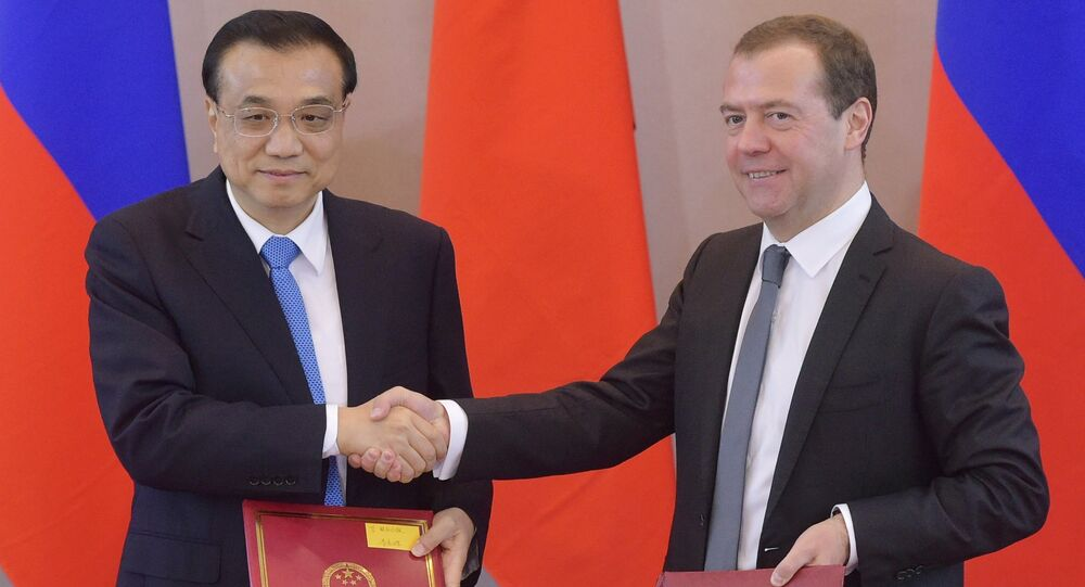 Russian Prime Minister Dmitry Medvedev and Chinese Premier Li Keqiang attending the document-signing ceremony following the 21st regular meeting of the heads of the Russian and Chinese government in St.Petersburg