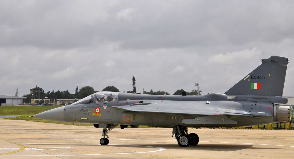 An Indian Air Force (IAF) pilot taxies a newly commissioned Tejas or Light Combat Aircraft (LCA) on a runway in Bangalore during a ceremony in the southern Indian city. (File)