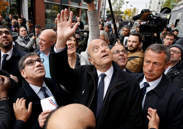 French politician Alain Juppe (C), current mayor of Bordeaux, a member of the conservative Les Republicains political party and candidate for their presidential primary, visits the esplanade of Argenteuil, Paris suburb, France, November 2, 2016