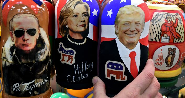 Traditional Russian wooden nesting dolls, Matryoshka dolls, depicting Russia's President Vladimir Putin, US Democratic presidential nominee Hillary Clinton and US Republican presidential nominee Donald Trump are seen on sale at a gift shop in central Moscow on November 8, 2016