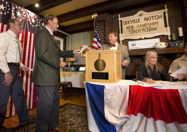 Voters in Dixville Notch, Va., cast their ballots just after midnight Tuesday, Nov. 8, 2016, in Dixville Notch, N.H.