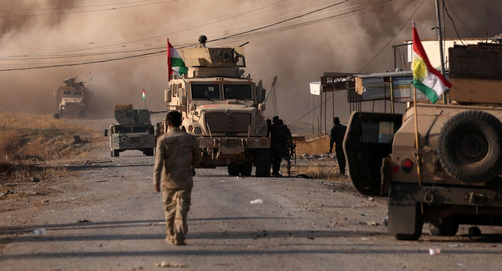 Smoke rises during clashes between Peshmerga forces and Islamic State militants in the town of Bashiqa, east of Mosul, during an operation to attack Islamic State militants in Mosul, Iraq, November 7, 2016