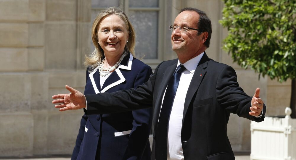 US Secretary of State Hillary Rodham Clinton is greeted by French President Francois Hollande prior to their meeting at the Elysee Palace in Paris (File)