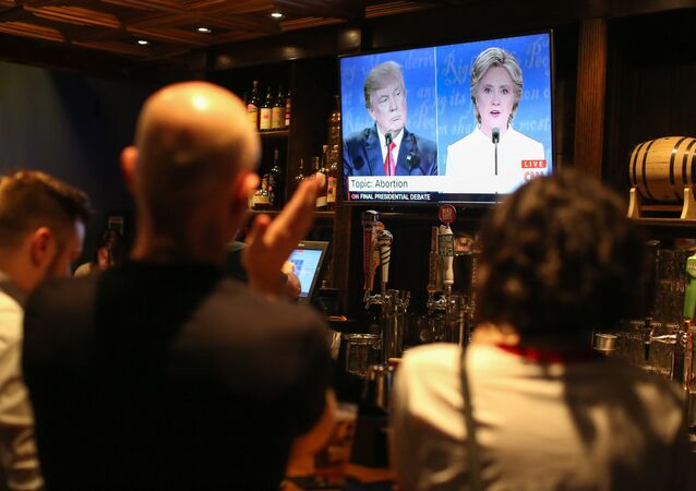 People watch the third presidential debate between presidential debate between US Democratic presidential candidate Hillary Clinton and US Republican presidential candidate Donald Trump at Murphy's Tap House in uptown Charlotte, North Carolina on October 19, 2016