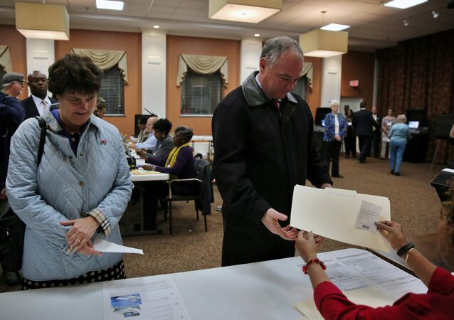 Democratic U.S. vice presidential candidate Senator Tim Kaine (D-VA) arrives to cast his ballot accompanied by his wife Anne Holton (L) at the Hermitage Methodist Home polling station in Richmond, Virginia, U.S. November 8, 2016